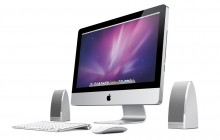 Amazilla Dyad Desk luidsprekers naast Apple iMac